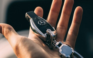 A person's hand holding car keys representing the bail bond collateral services by A-Affordable Bail Bonds in Vancouver, WA
