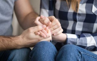A man and woman holding hands representing needing bail bond services from A-Affordable Bail Bonds in Washington State